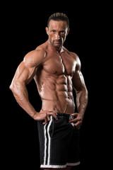 Muscular Bodybuilder Guy Posing Over Black Background
