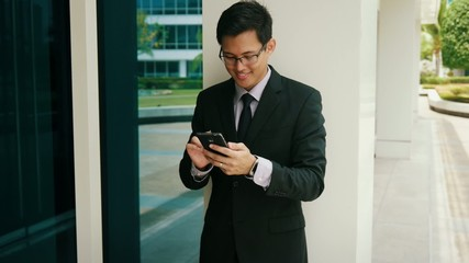 Businessman Writing With Pen On Mobile Phone Smartphone