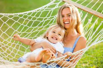 Happy mother and daughter in hammock