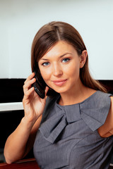 Businesswoman using mobile phone in the office