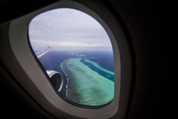 Maldives, Tropical islands seen from plane window