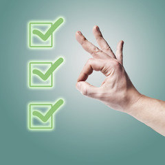Hand OK sign isolated with three green check marks