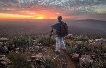 USA, California, Cleveland National Forest, Tourist looking at sunset from Viejas Mountain