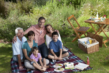 Three generation family in park, having picnic