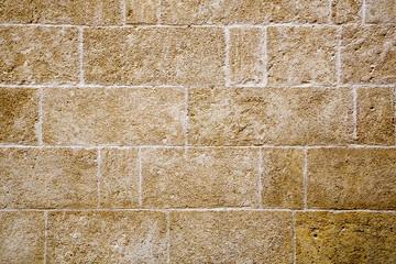 Muro di mattoni in pietra