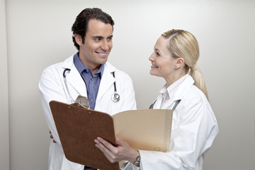 Two doctors with clipboard