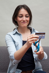 Woman cutting credit card in half