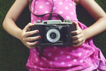 Girl holding vintage camera