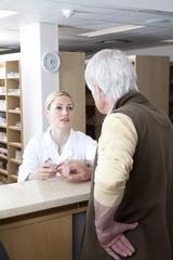 Female Pharmacist talking to a customer