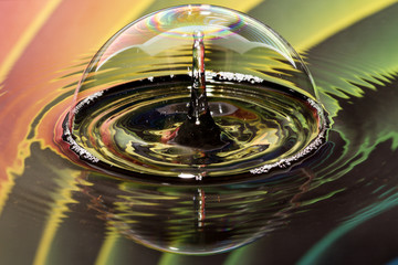 Water drops on bubble with rainbow background