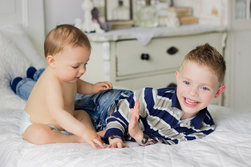 Netherlands, Brothers (4-5) playing on bed