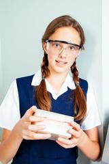Teenage school girl in science class