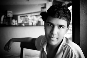 Boy Sitting In A Cafe