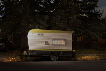 Travel trailer on street at night