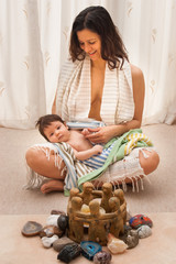 Woman sitting on floor with baby