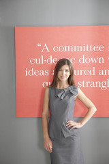 Portrait of businesswoman in front of inspirational quote