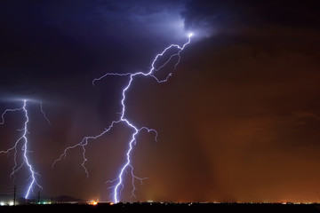 USA, Arizona, Maricopa County, Hassayampa, Lightning striking in farming area near little town