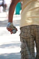 Man holding boule