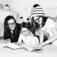Girls (4-5), (10-11, 12-13) reading book