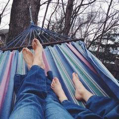 Woman and girl lying on hammock