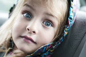 Portrait of little girl with surprised expression on her face