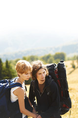 Young couple with backpacks outdoors