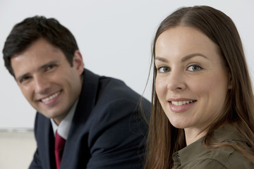 Businessman and Business woman smiling