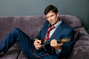 Businessman playing toy guitar