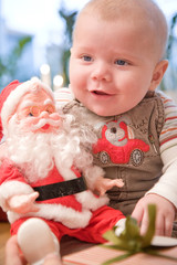 Baby boy with Father Christmas toy