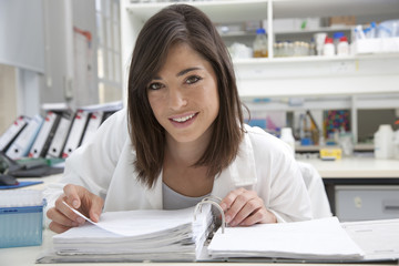 Female technician studying in laboratory