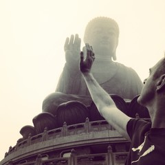 China, Hong Kong, Man with High-Fiving Buddha