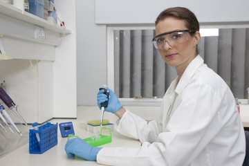 Technician using micro pipette