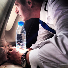 Pilot looking through plane's window