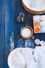 Baking still life with eggs, flour, milk, to make cake, dough .