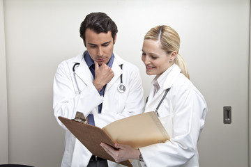Two Doctors examining medical chart in hospital