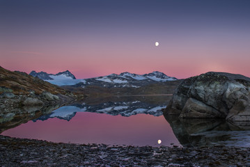 Mountains and water reflected in moonlight