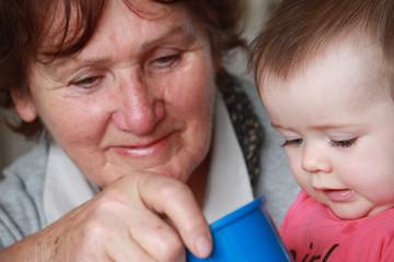 Grandmother with grandchild (2-3)