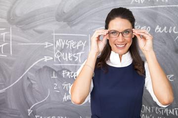 Businesswoman in front of blackboard