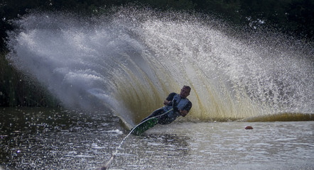 Water-skier skiing slalom course