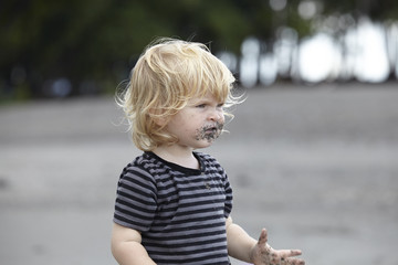 Toddler (18-23 months) playing with sand