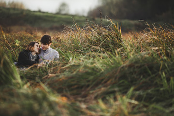 View of couple in field
