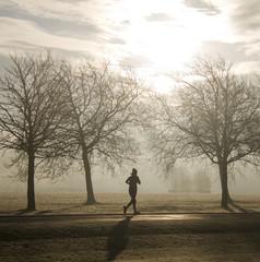 UK, Jogger running through the park