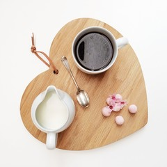 Heart shaped board with coffee and truffles