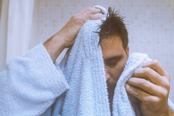 Man drying his face with towel
