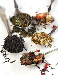 Different tea types: black, green, floral and herbal on white