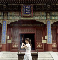 China, Beijing, Woman praying at temple