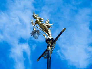 Lamp sculpture half-bird half-woman.