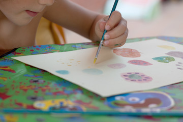 Child (6-7) painting with watercolors
