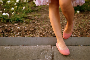 Spain, Catalonia, Barcelona, View of woman's legs in ballerina shoe