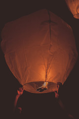 Paper lantern flying at night